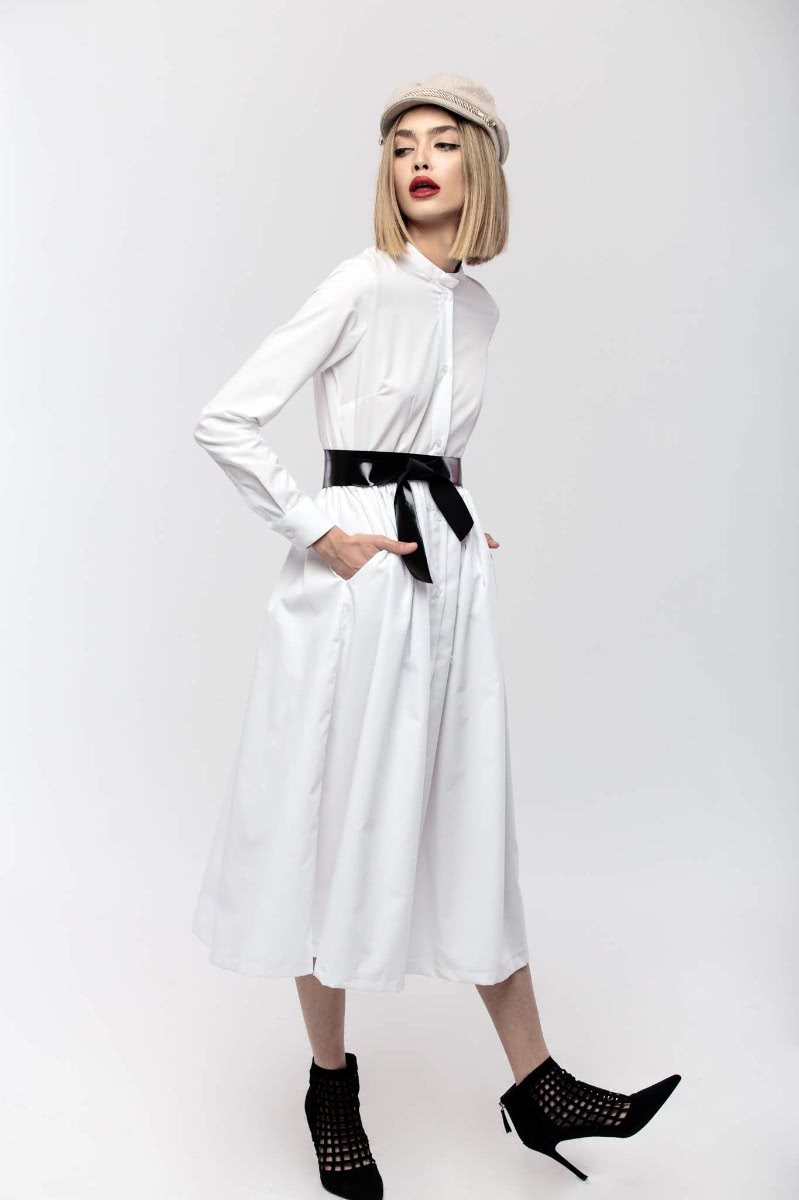 White (100% cotton) dress, with pockets, and black waistband.