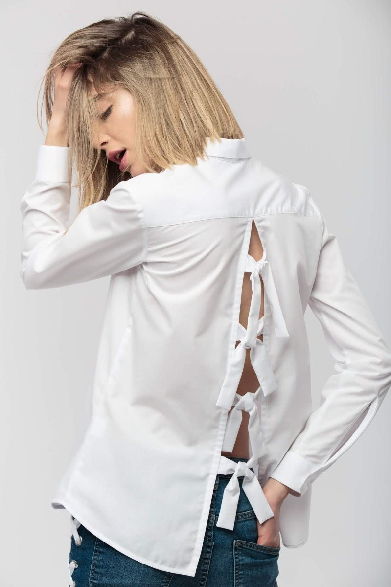 Long sleeved blouse, made from 100% cotton, with a partial front button placket and ornamental band around the bib.